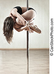 Young slim woman - Young slim pole dance woman.