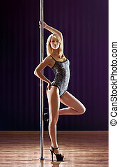 Young slim woman - Young slim pole dance woman.