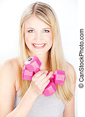 smiled woman holding two weights