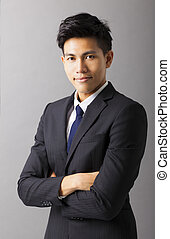 young smiling asian businessman