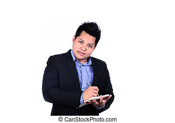 Young smiling Asian businessman taking notes isolated on a white