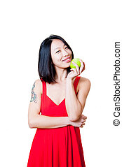 Young smiling asian woman red dress with green apple isolated