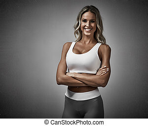 Young beautiful smiling athletic girl. Sport and fitness concept.