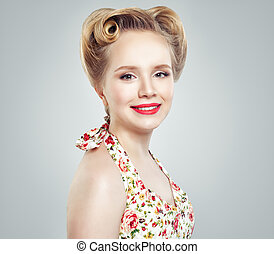 8f308532e51f Young smiling blonde woman on gray background