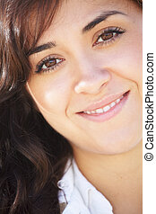 Young smiling brunette woman