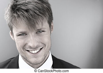 Stylized cool portrait of a happy smiling young businessman
