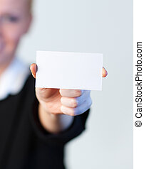 smiling Business woman holding out a business card