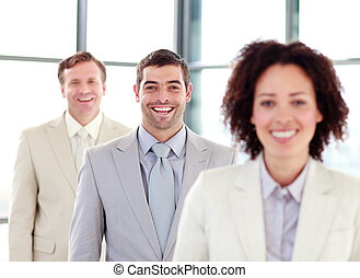 Young smiling businessman with his team