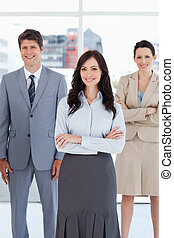 Young smiling businesswoman crossing her arms in front of...