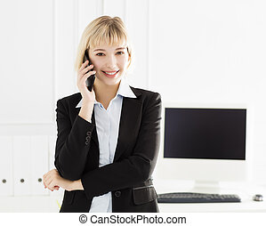 young smiling businesswoman standing in office