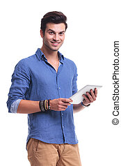 young smiling casual man holding a pad tablet