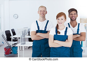 Young smiling cleaners - Group of young smiling cleaners...