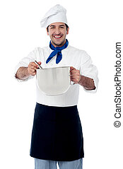 Young smiling confident male chef