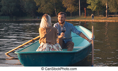 Young smiling couple in a boat