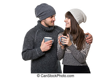 Young smiling couple with mugs