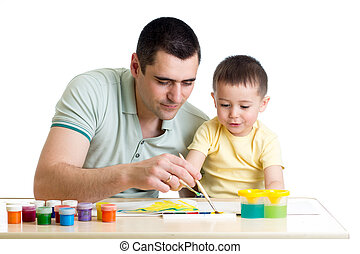 young smiling father painting with son