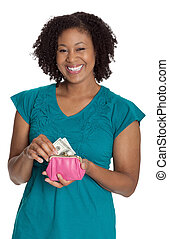 Young smiling female pulling money from her purse, isolated against white background