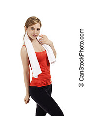 young smiling fitness woman with a white towel on white background