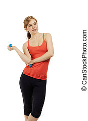 young smiling fitness woman with blue dumbbells looking to side on white background