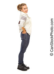 Young smiling girl in jeans