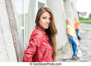 Young smiling girl in red jacket