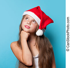 Young smiling girl in Santas hat