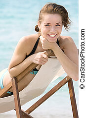 young smiling girl on beach