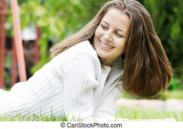 young smiling girl on natural background