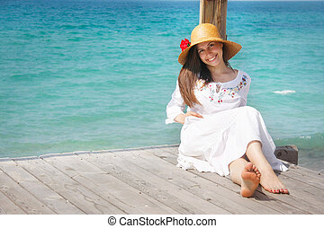 young smiling girl on sea background