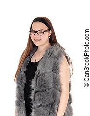 Young smiling girl standing in her fur jacket with glasses