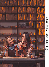 Young smiling girls at work