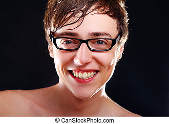 Young smiling guy in glasses