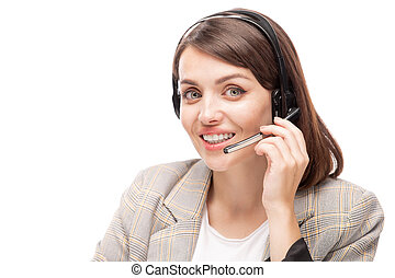Young smiling hotline consultant in headset answering question of client