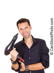 smiling male barber with hair dryer - young smiling male ...