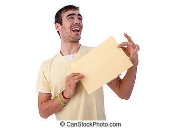 young smiling man holding a yelow sheet of paper in his hand; isolated on the white background. Studio shot.