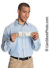 Young smiling man holding an American dollar bill against white background