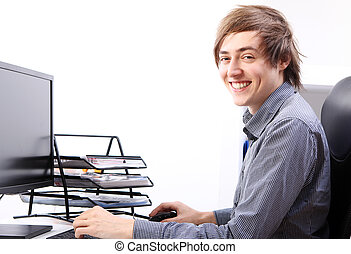 Young smiling man in office
