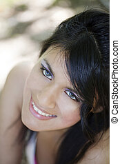 Young smiling portrait attractive hispanic woman outdoors