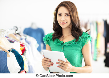young smiling Sales assistant in clothing store