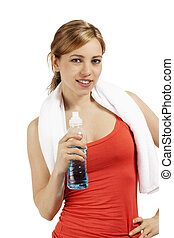 young smiling sporty woman with a bottle of water on white background