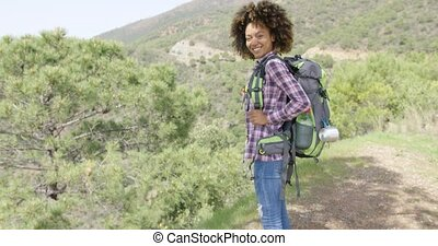 Young smiling tourist - Young cheerful female in casual...