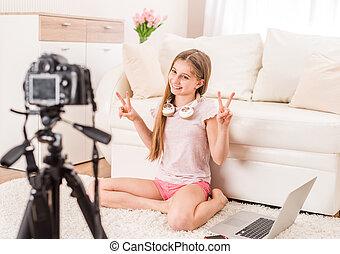 Young smiling videobloger teen girl