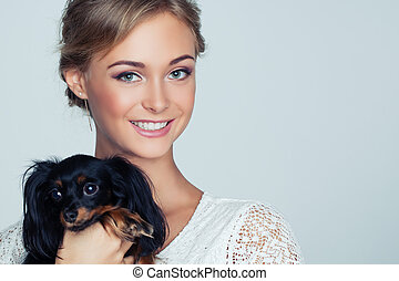 Young Smiling Woman and Puppy Dog on White Background, Closeup Portrait