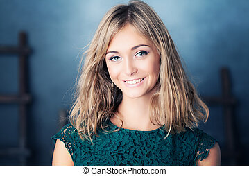 Young Smiling Woman. Beauty Portrait of Young Fashion Model