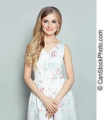 Young smiling woman fashion portrait