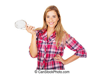 Young smiling woman holding a mirror