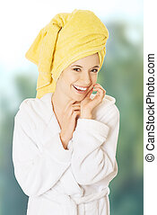 Young smiling woman in bathrobe