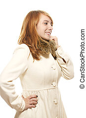 young smiling woman in fawn winter coat on white background