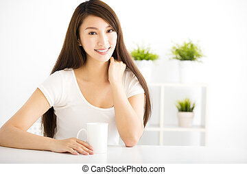 young smiling woman  in living room