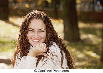 Young smiling woman in park